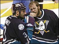 Stanley Cup MVP Jean-Sebastien Giguere (right) is inconsolable after loss.