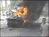 Burning wreckage of car