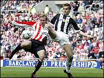 Sunderland's Michael Proctor is closed down by Jonathan Woodgate