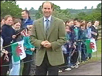 The prince is greeted by children as he arrives in Brecon