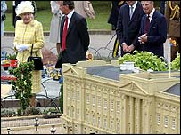 The Queen inspects Buckingham Palace, made entirely of Lego bricks