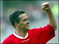 Michael Owen celebrates hitting his fourth goal of the game