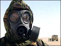 Lieutenant Simon Keyes of the Joint Nuclear, Biological and Chemical (NBC) Regiment, wearing his NBC suit and respirator