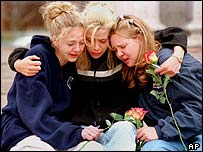 Students from Columbine high school comfort each other