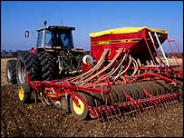 Farmer sowing cereal crop