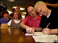 Michael Stark (right) and Michael Leshner fill out their applications for a marriage licence, Toronto, 10 June 2003
