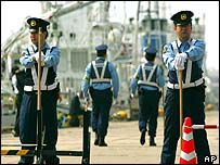 Police officers stand guard at a Niigata port, central Japan, where a North Korean ferry was scheduled to make a port call on Sunday