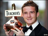 Barry Ferguson shows off his award