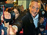 Nestor Kirchner shakes hands with well-wishers before casting his vote