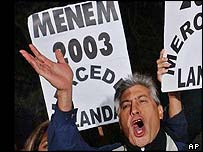 Supporters of former President Carlos Menem celebrate outside his headquarters in Buenos Aires