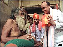 World Hindu Council leader Praveen Togadia (right) greets Hindu spiritual leader Ramachandra Paramhans