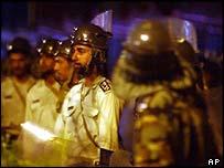 Iranian riot police facing demonstrators