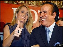 Carlos Menem with his wife Cecilia Bolocco as results came in