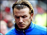 A dejected-looking David Beckham heads to the substitutes bench