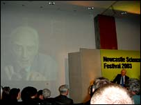 James Watson listens as his colleague Francis Crick talks by video-link