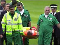 Headingley ground authorities carry the injured steward from the ground