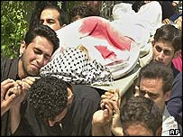 Mourners carry victim of second Israeli air strike