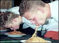 Men eating spaghetti