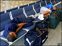 Stranded passengers sleep in an airport