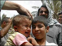 Toddler Abbas with members of Abu Khazal family