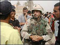 Lt-Col Jack Kammerer talking to residents of Hai al-Muallimin