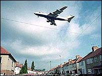 airplane flying over houses