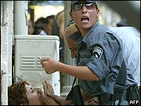 Israeli police assist shocked woman after a suicide bomber