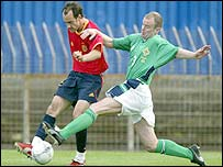 Northern Ireland defender Peter Kennedy stretches to tackle Etxberria of Spain at Windsor Park