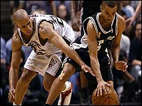 Richard Jefferson and Tony Parker battle for control