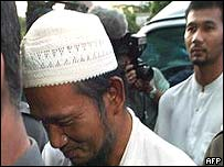Terrorist suspects Maisuri Haji Abdullah (C) and his son Mayahi Haji Doloh (behind-R),