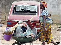Woman flees fighting in western Ivory Coast