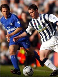 Jason Koumas (right) in action against Chelsea's Gianfranco Zola