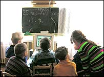 School children looking at internet
