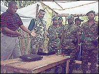 FDD rebel leader Pierre Nkurunziza (l) and FDD fighters