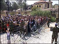 Greek Cypriots queue to cross the border