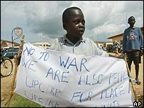 Congolese boy holds a peace banner