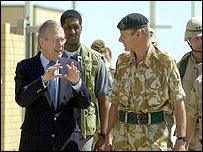 Donald Rumsfeld talks to UK's Major General Brimm in Basra