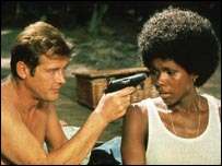 Roger Moore with Gloria Hendry in Live and Let Die