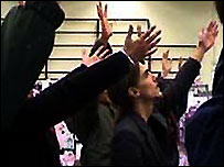 The congregation in mass prayer in a shopping centre
