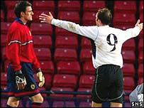 Paul Gallacher is disconsolate after his mistake allows Thomas Haas to score