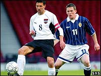 Thomas Floegel holds off Scotland's Gary Naysmith
