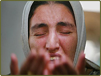 Mayadah Mohammed cries at the wake of her brother Hashim, who was allegedly killed by US soldiers during a raid on Monday at Duluiyah, 45 miles north of Baghdad.