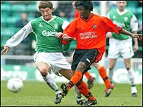 Russell Latapy (right) in action for Dundee United
