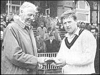 Peter Marner receives the man-of-the-match award from Frank Woolley