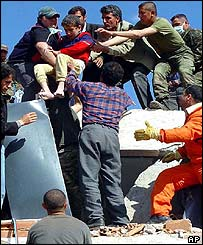 Child being rescued from the rubble of the school