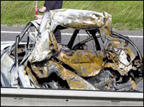 Burnt out police car