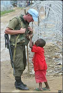 Child with Uruguayan UN peacekeeper