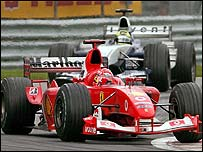 Michael Schumacher holds off brother Ralf on the final lap