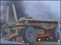 US Army vehicle smoulders after attack