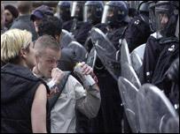 Police in riot gear in Trafalgar Square
